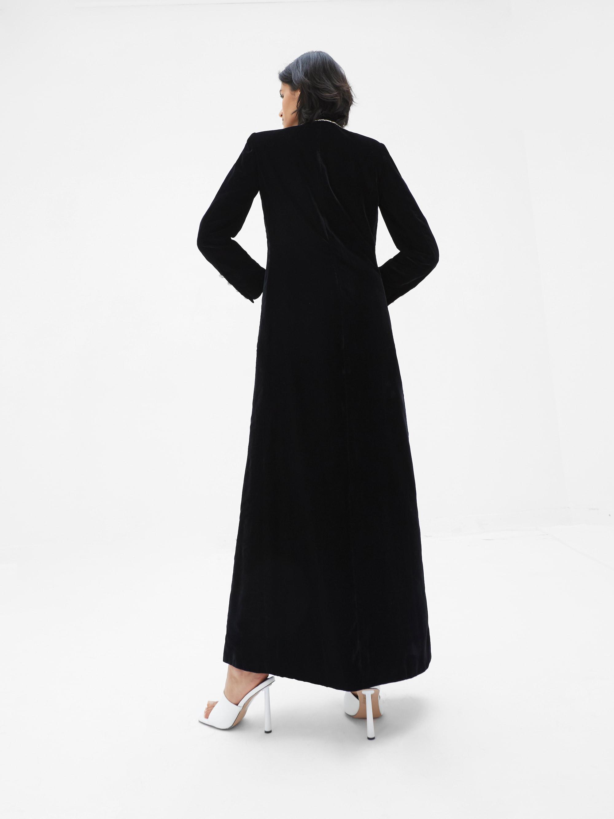View 2 of model wearing Kalia Kimono in black.