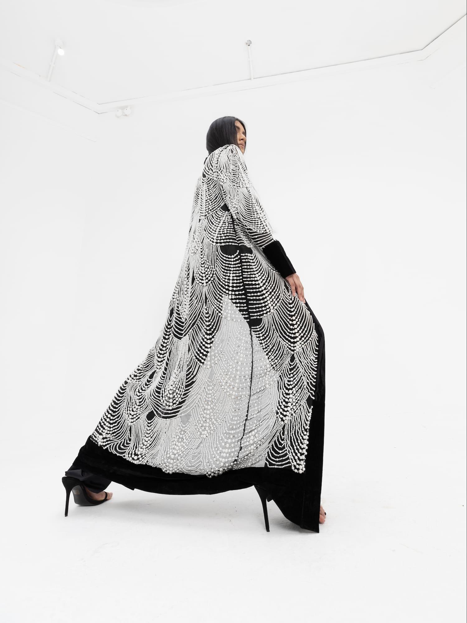 View 4 of model wearing Khhatak Kimono top in black.