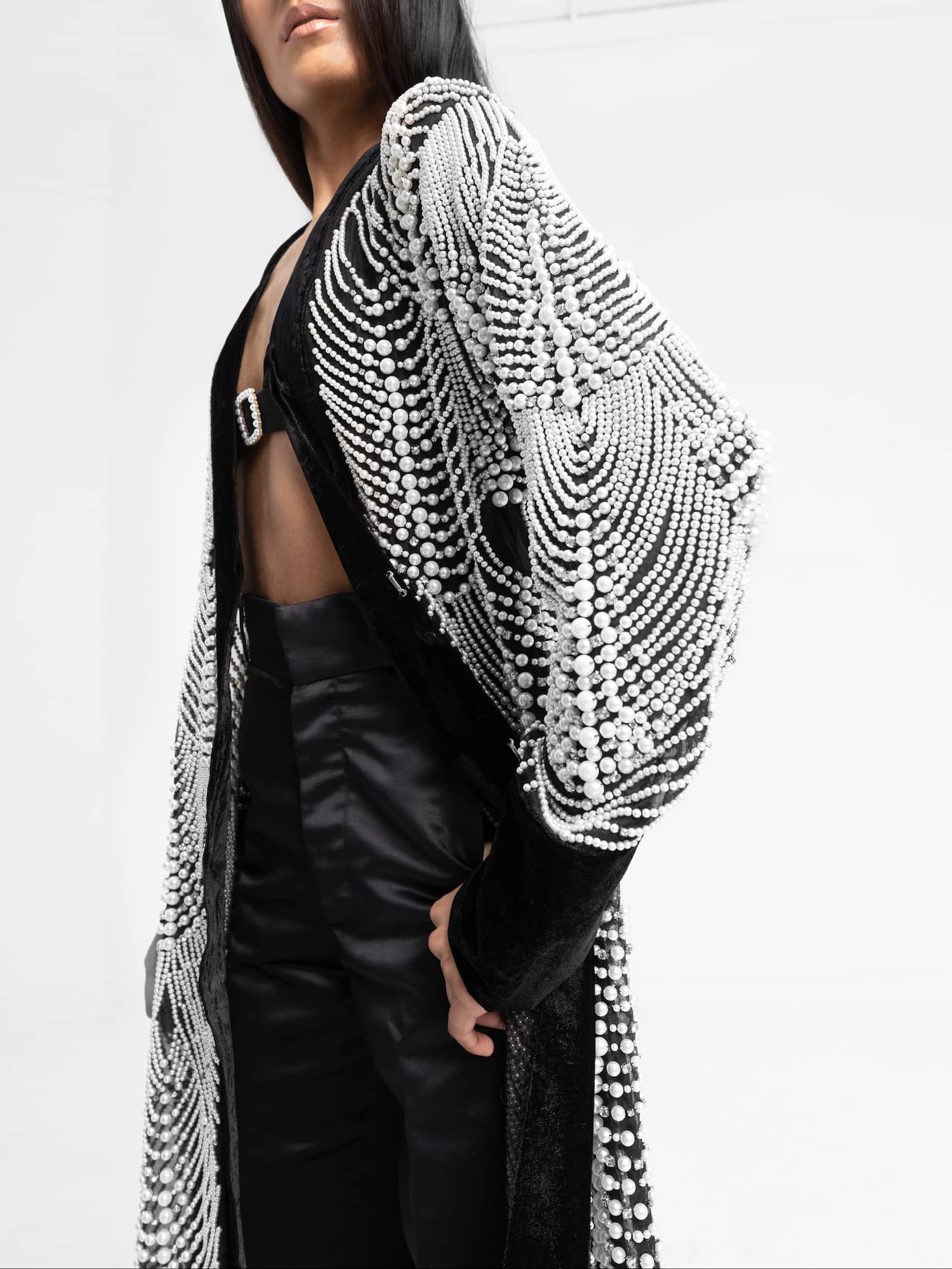 View 2 of model wearing Khhatak Kimono top in black.