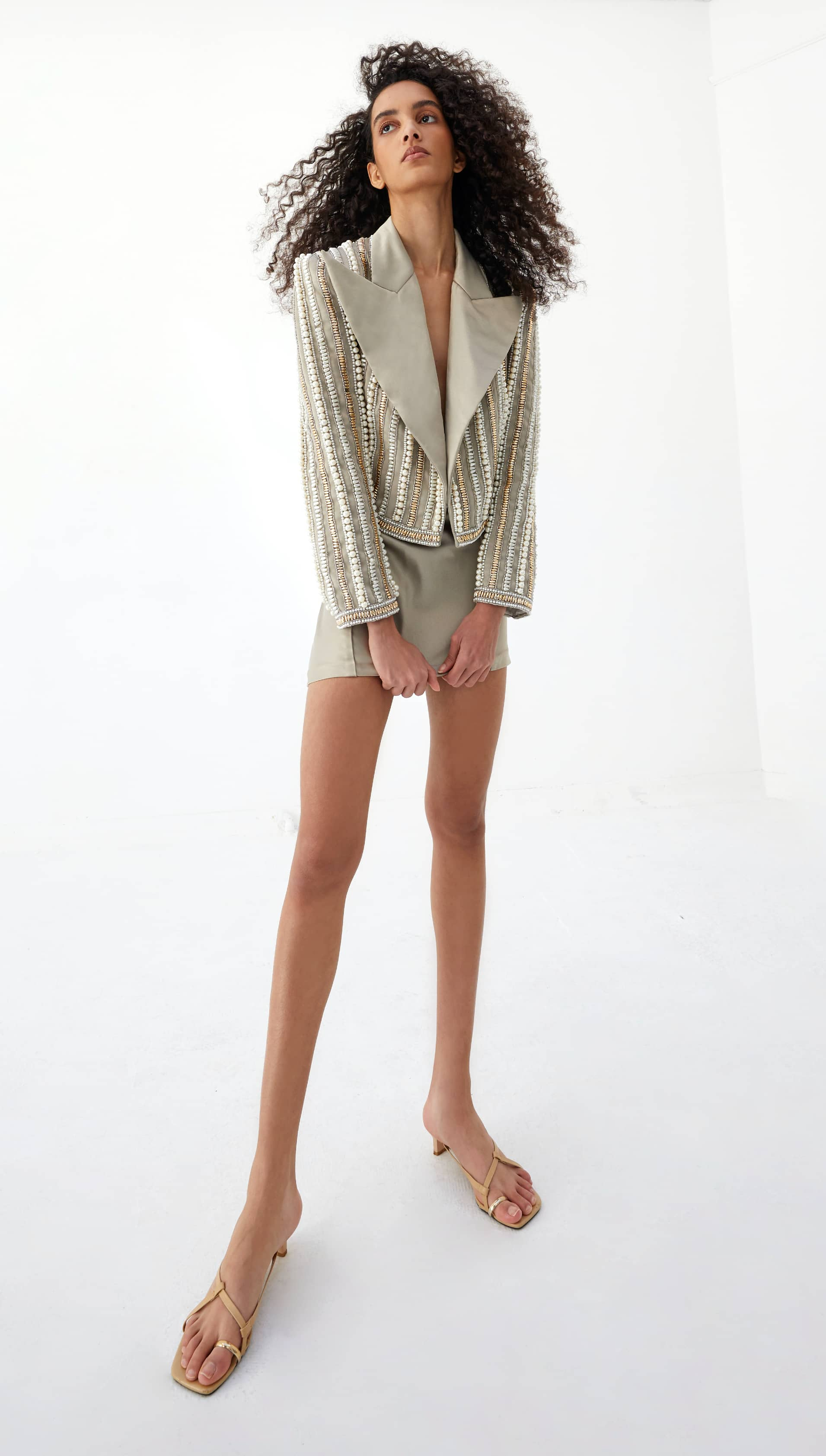 View 5 of model wearing Kaysa Blazer in pearl gold.