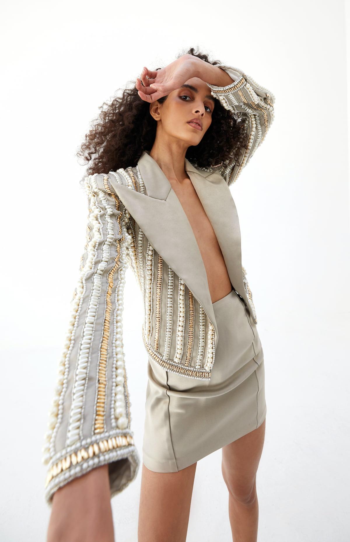 View 4 of model wearing Kaysa Blazer in pearl gold.