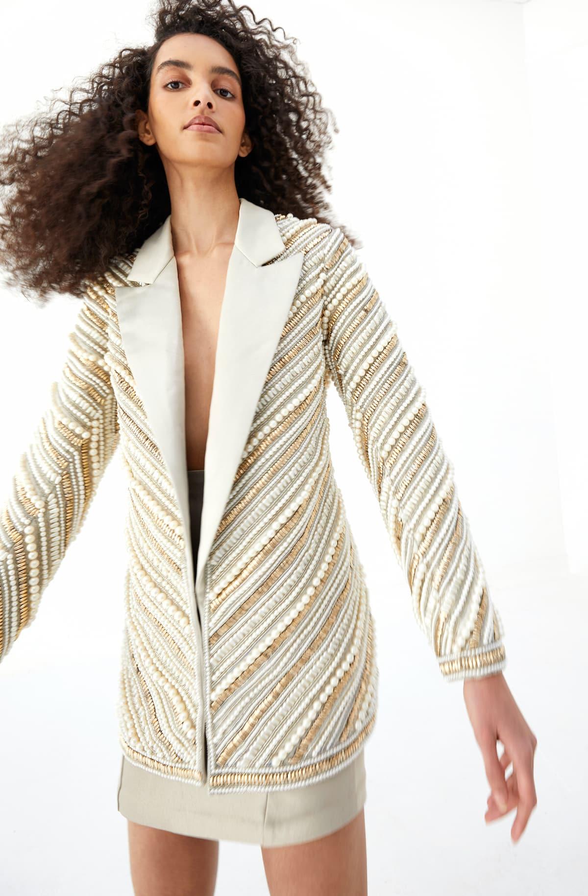 View 2 of model wearing Kasira Blazer in pearl gold.
