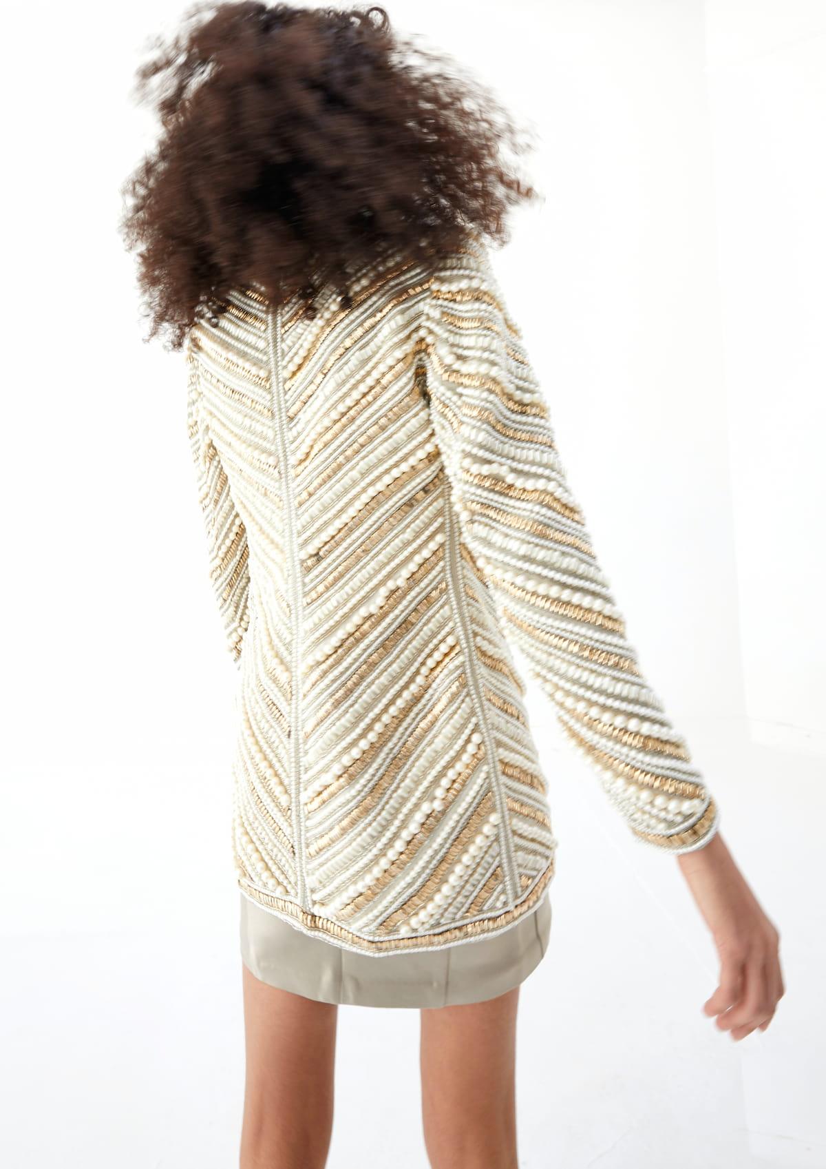 View 3 of model wearing Kasira Blazer in pearl gold.