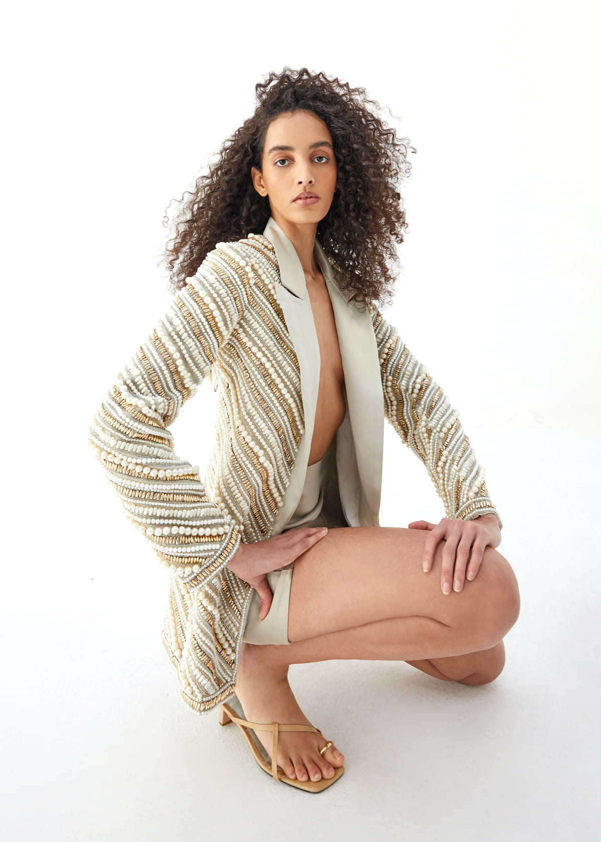 View 4 of model wearing Kasira Blazer in pearl gold.