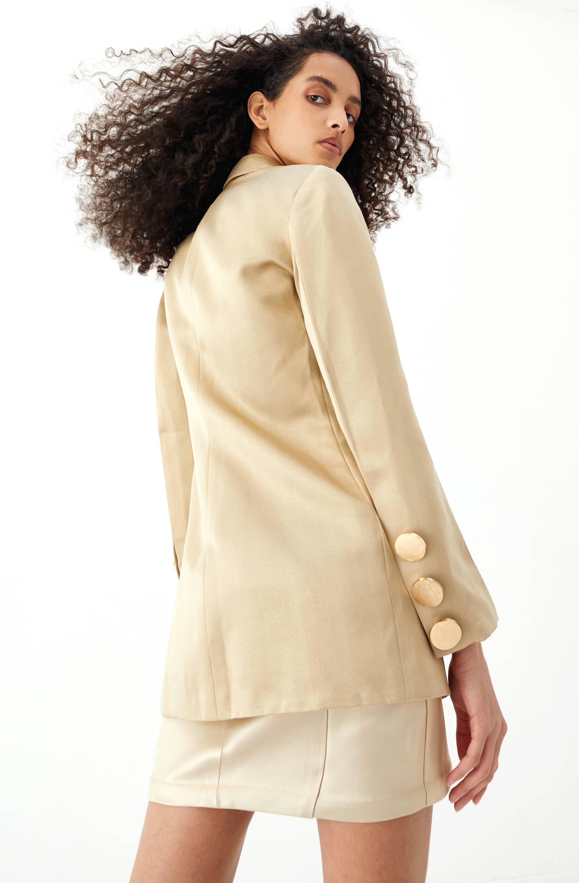 View 5 of model wearing Kalisa Blazer in sand gold.