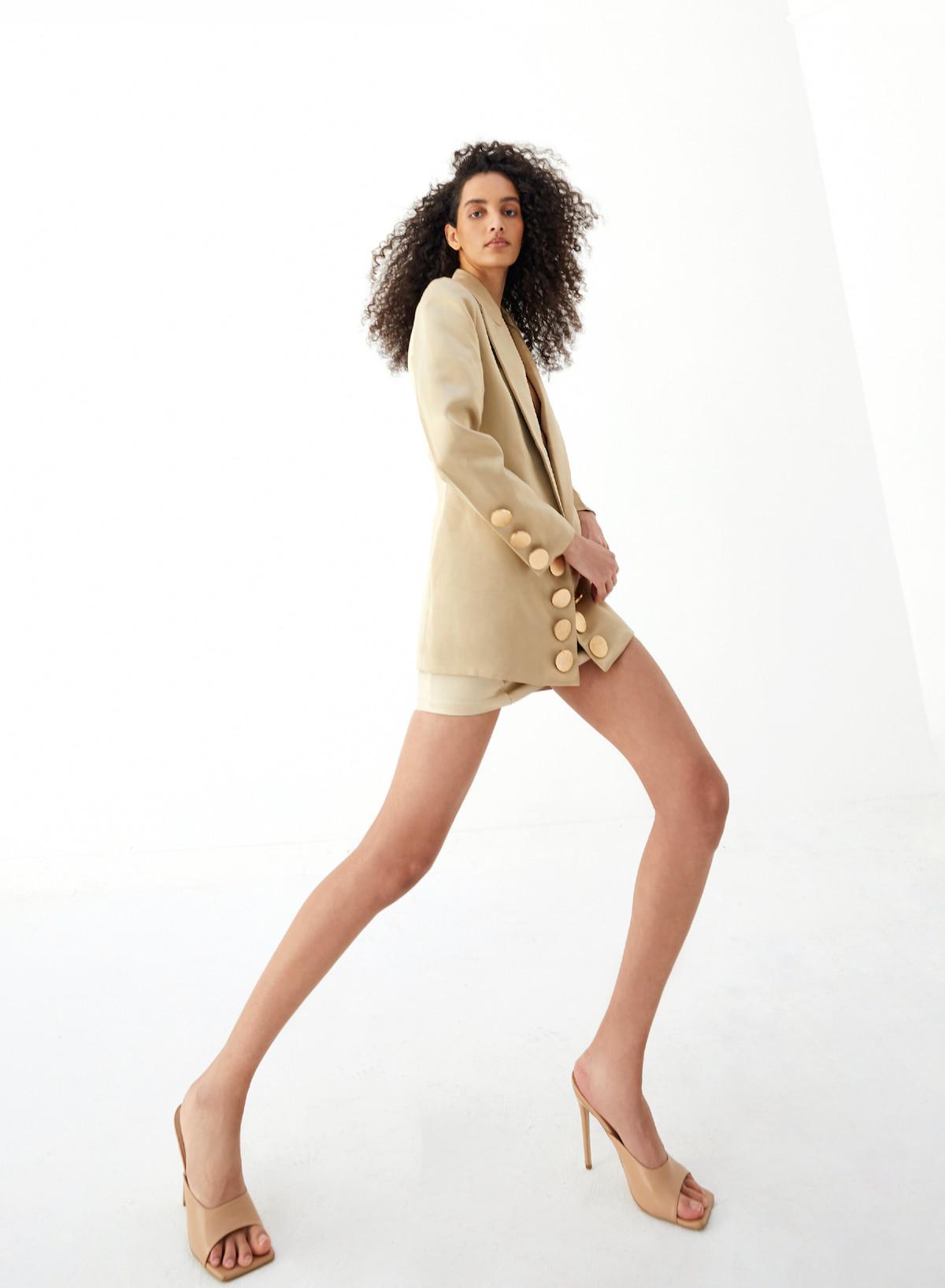 View 4 of model wearing Kalisa Blazer in sand gold.