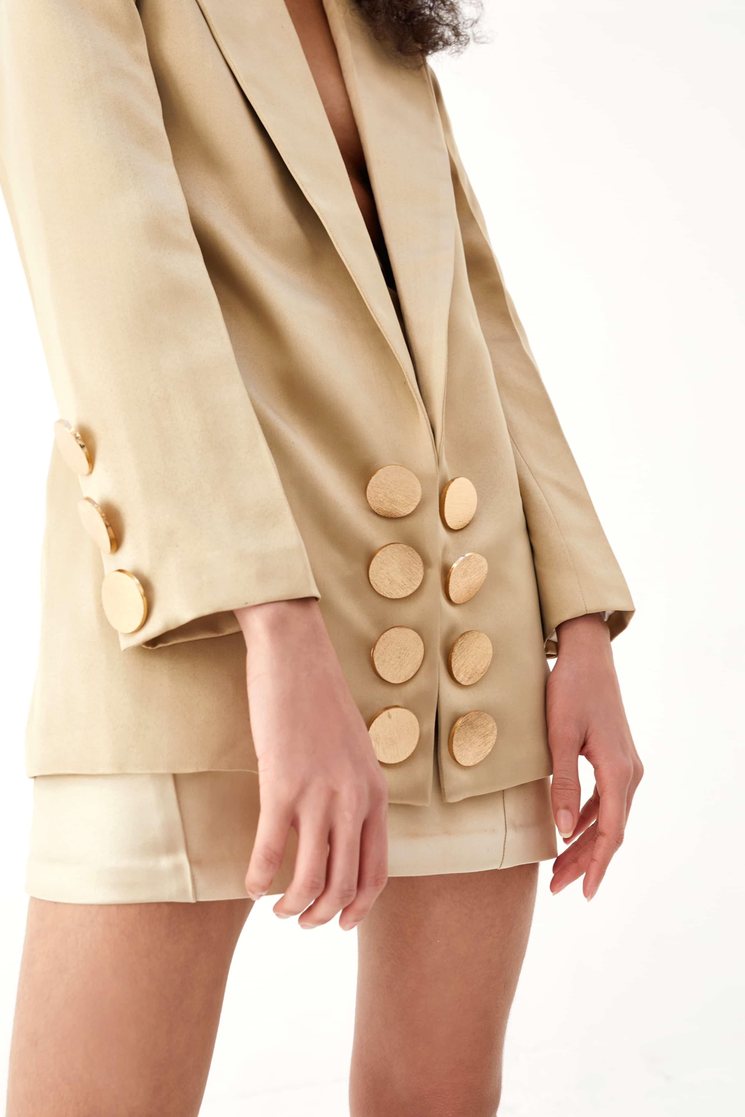 View 2 of model wearing Kalisa Blazer in sand gold.