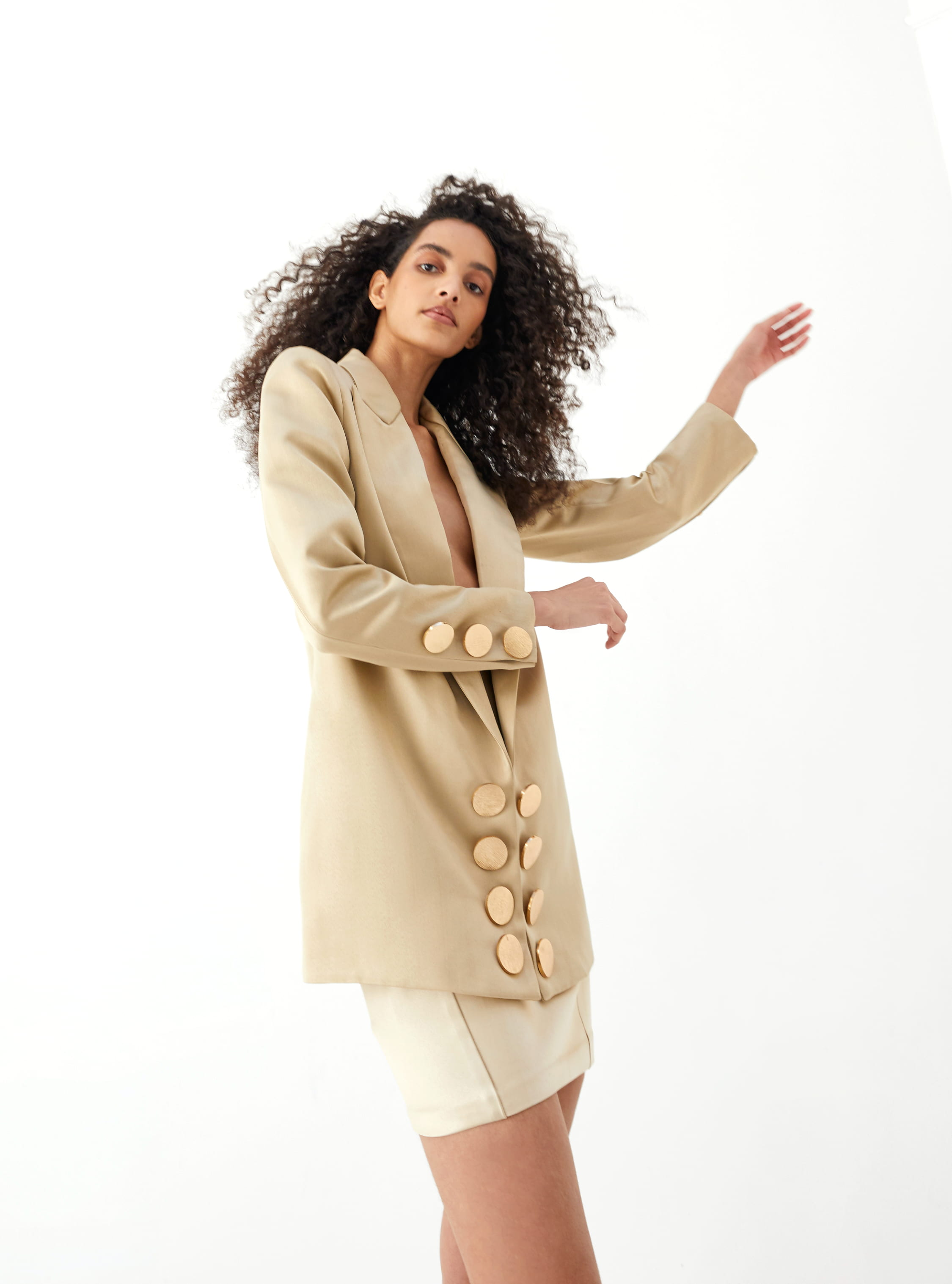 View 3 of model wearing Kalisa Blazer in sand gold.