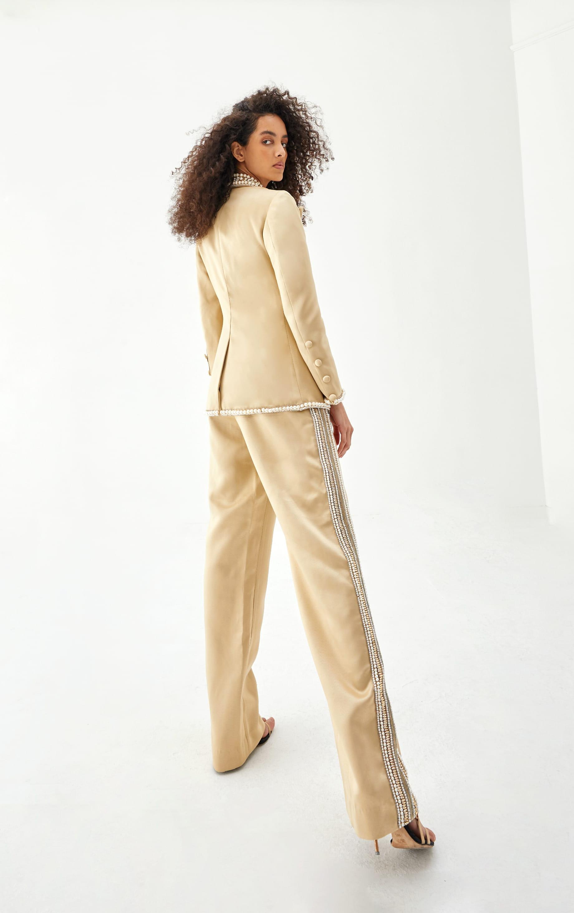 View 4 of model wearing Kismah Blazer in sand gold.