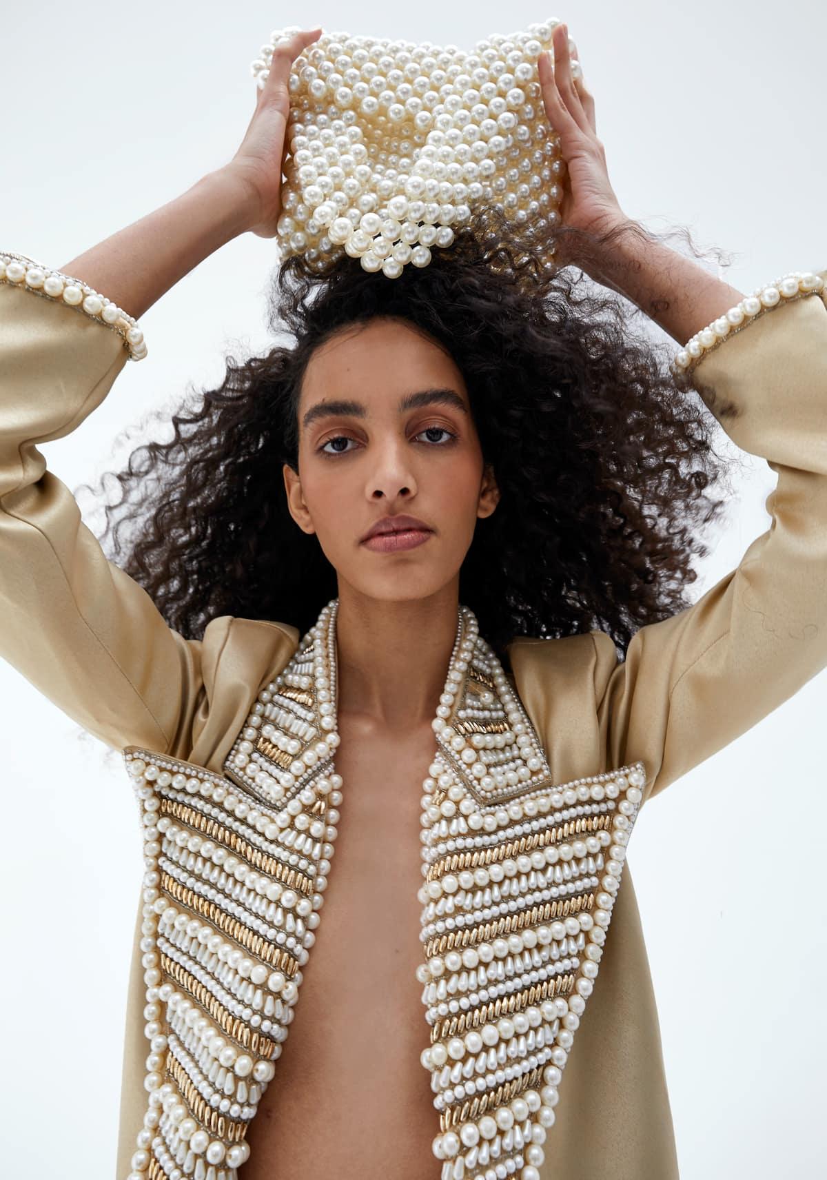 View 5 of model wearing Kismah Blazer in sand gold.