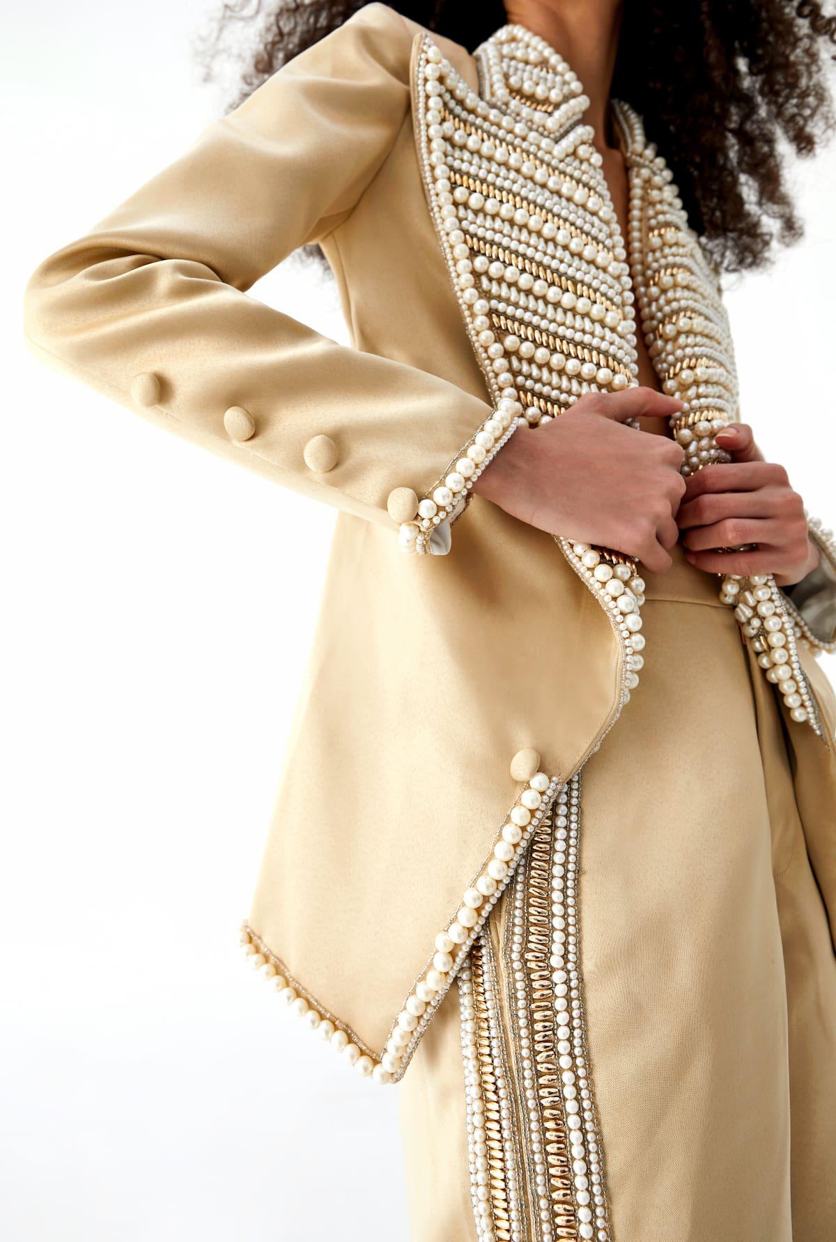 View 2 of model wearing Kismah Blazer in sand gold.