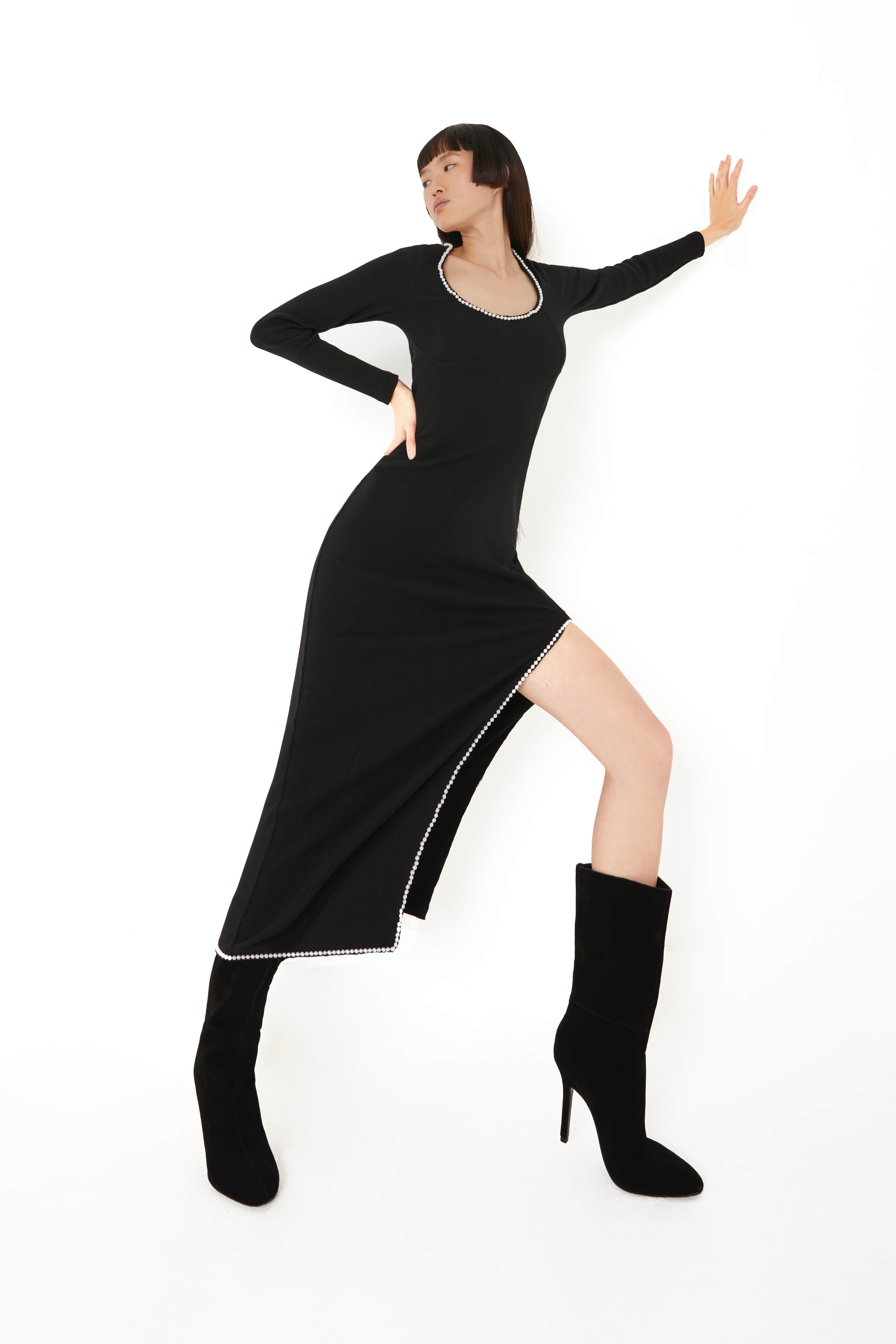 View 5 of model wearing Kmeya Maxi Dress in black.