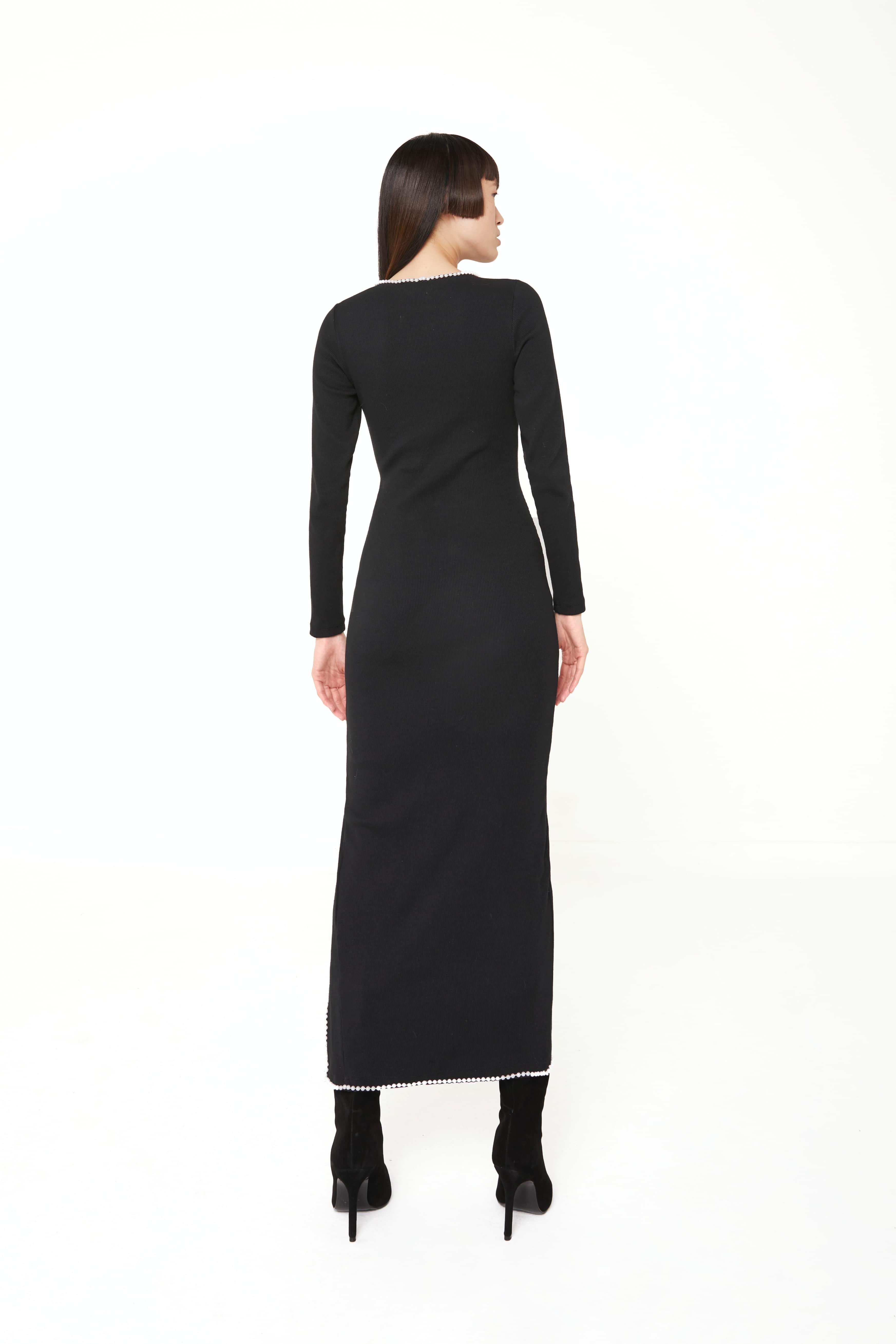 View 4 of model wearing Kmeya Maxi Dress in black.