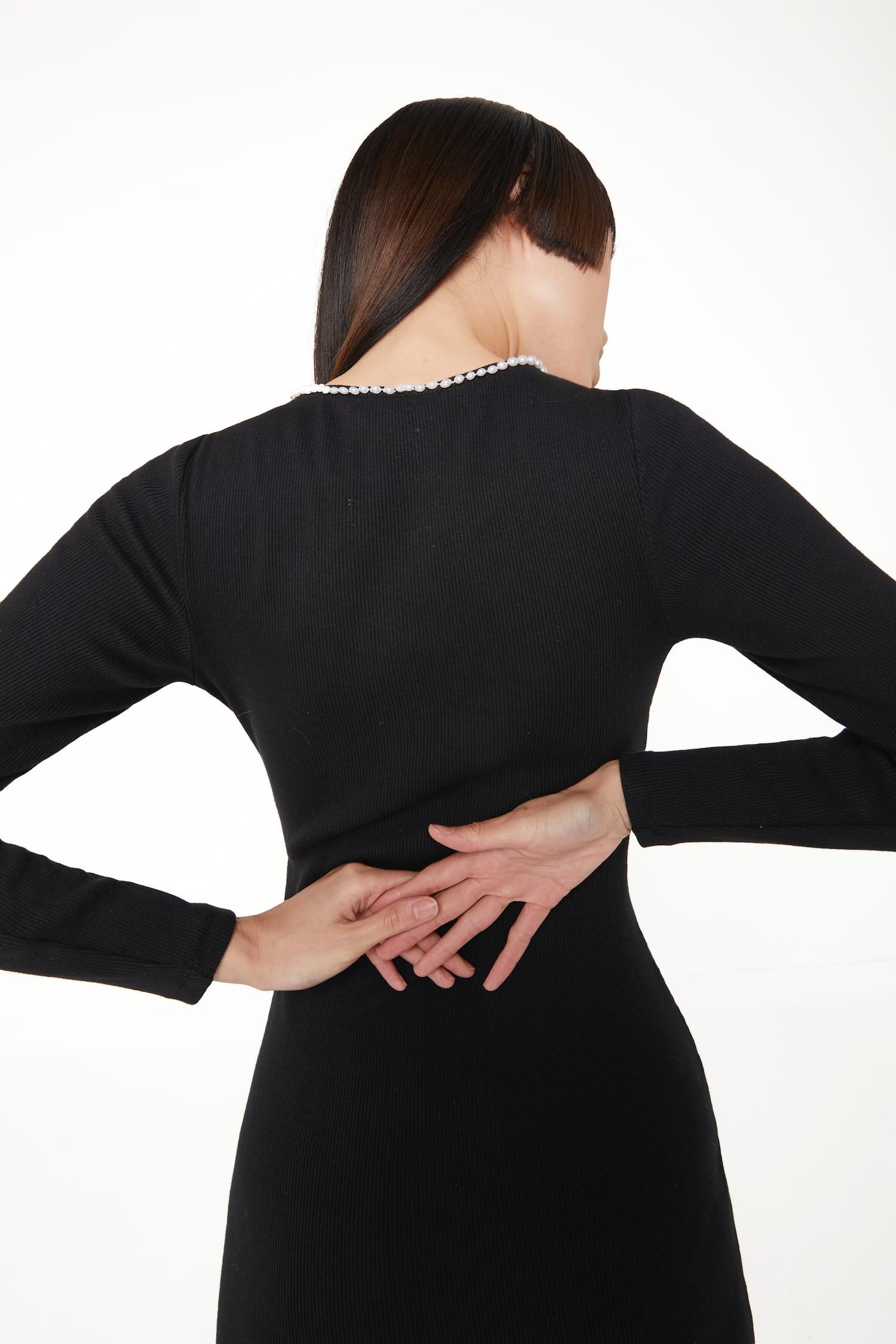 View 3 of model wearing Kmeya Maxi Dress in black.
