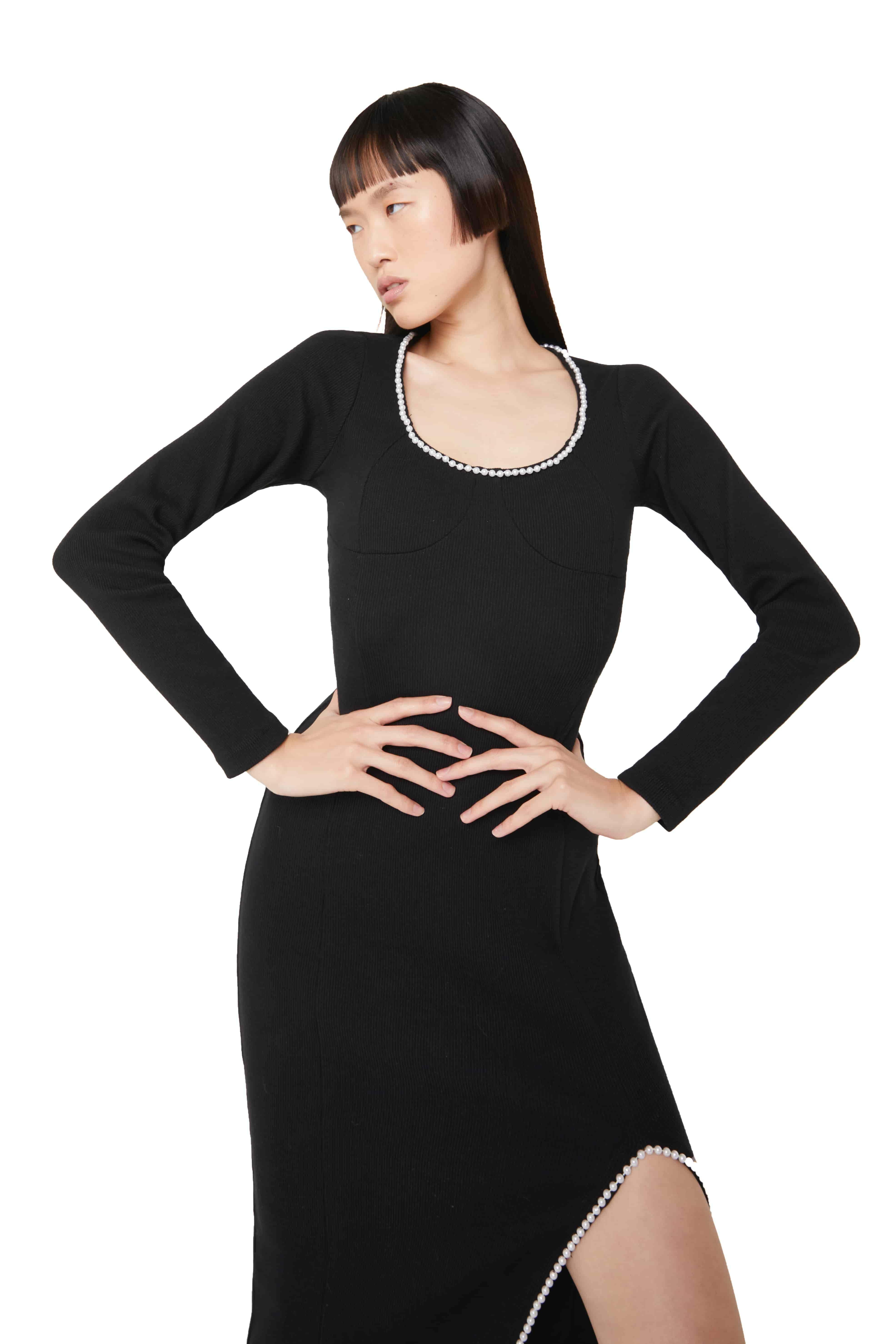 View 2 of model wearing Kmeya Maxi Dress in black.