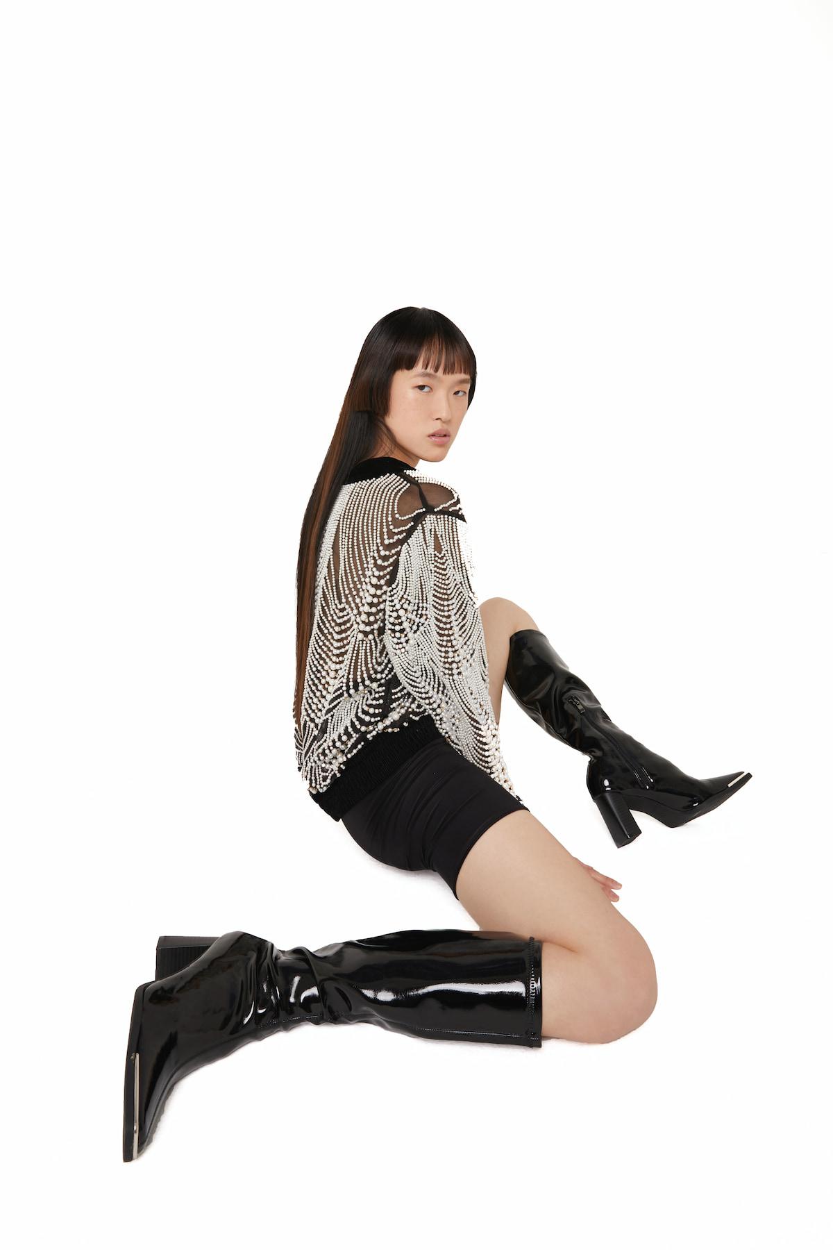 View 5 of model wearing Ktak Bomber in black.