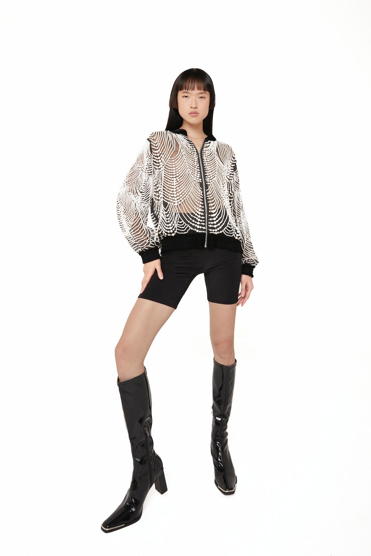 View 4 of model wearing Ktak Bomber in black.