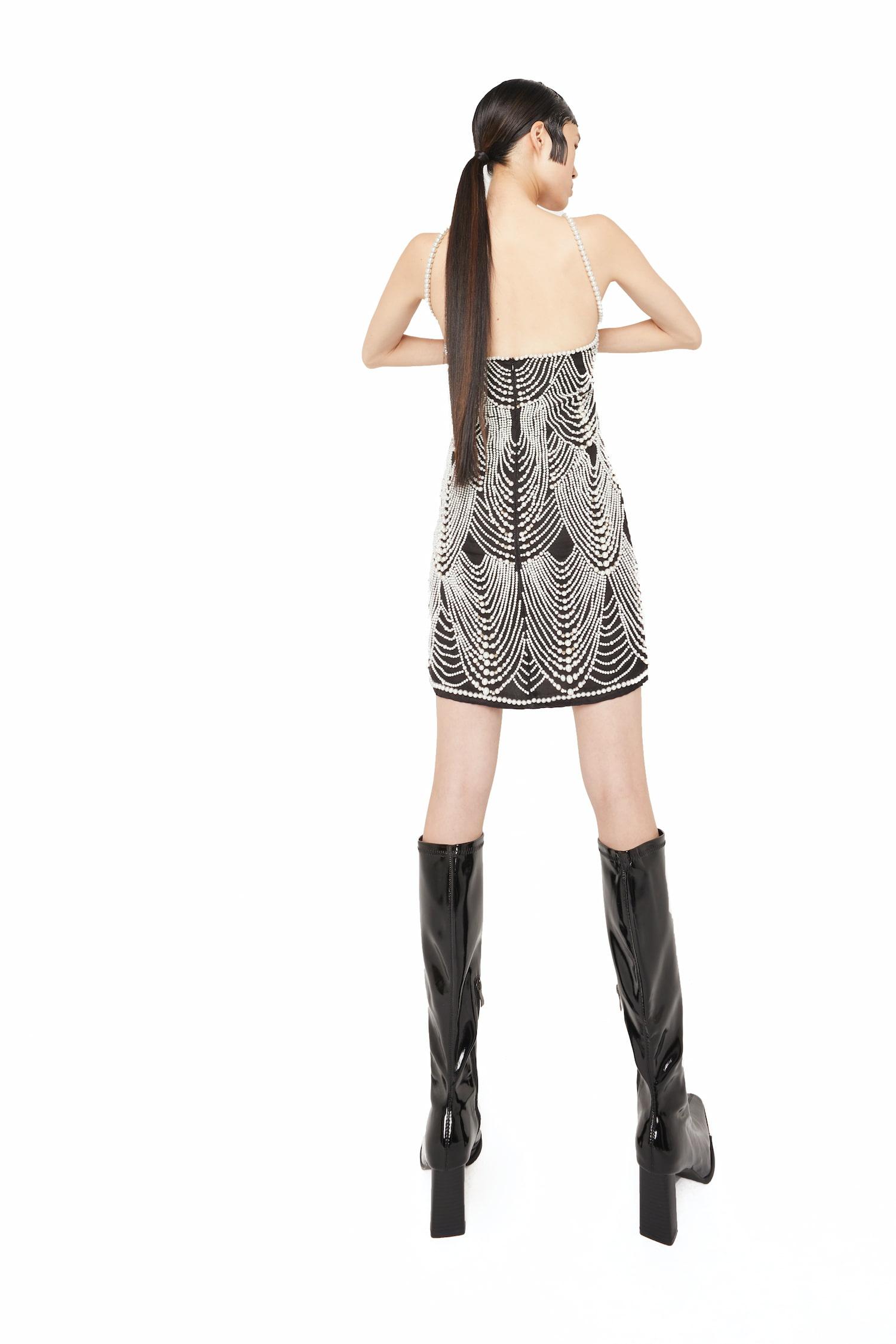 View 5 of model wearing Khha Mini Dress in black.