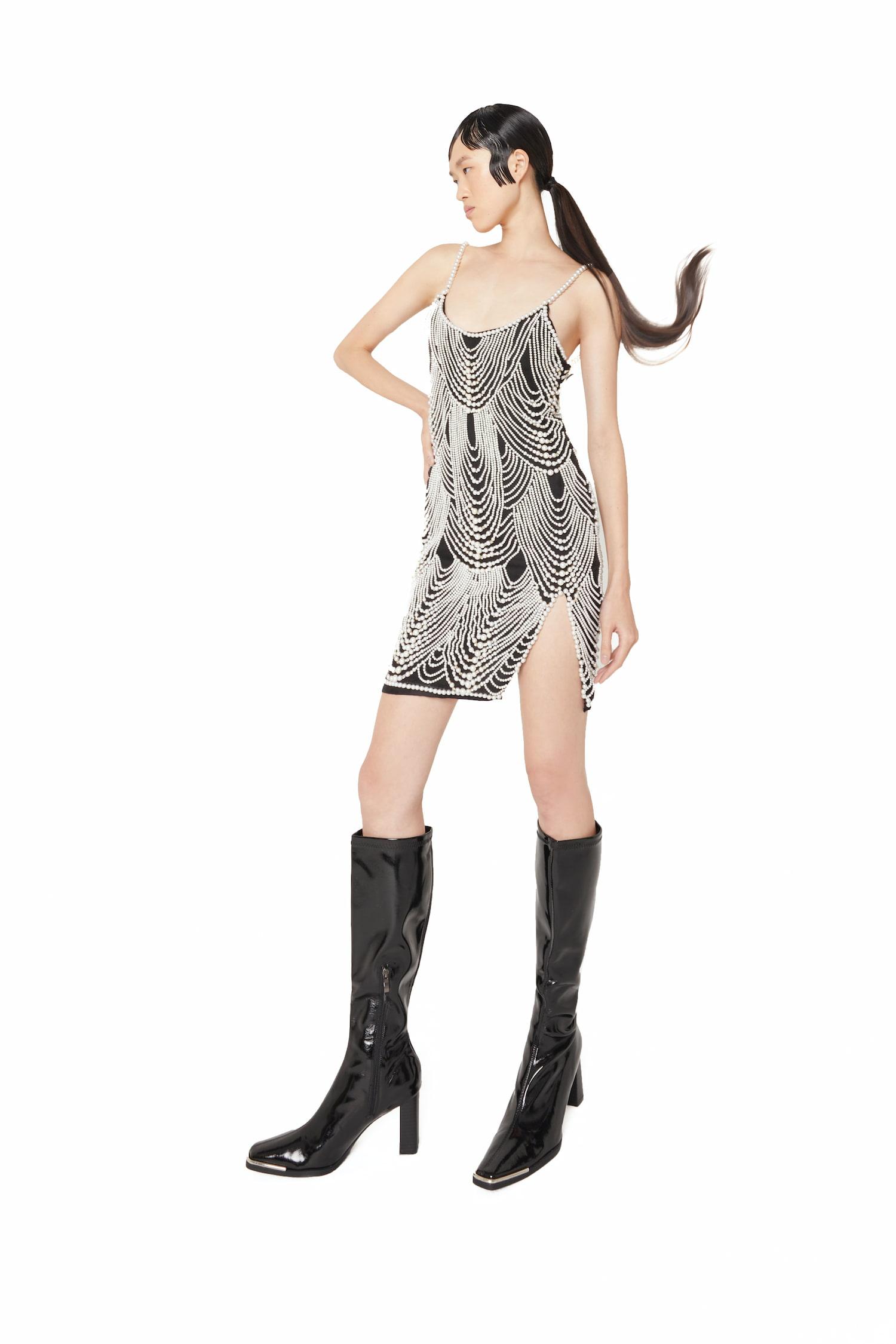 View 4 of model wearing Khha Mini Dress in black.