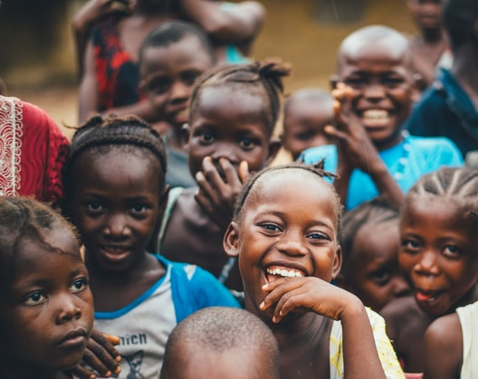 A group of kids smiling and laughing in Africa.