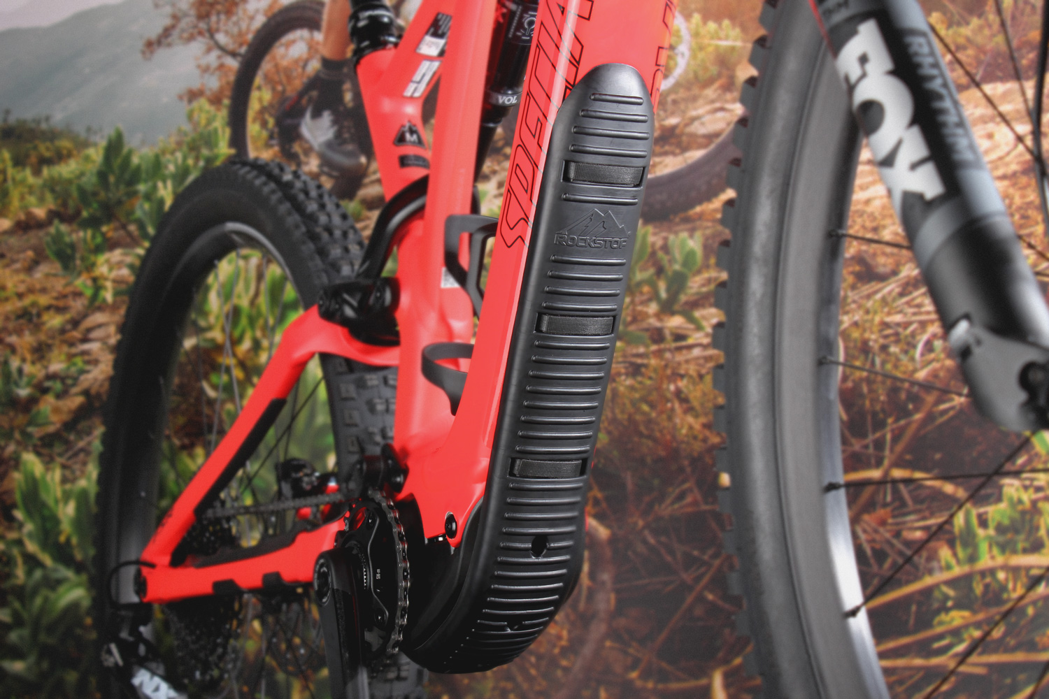A close up image of Frameguard situated on a red Specialized mountain bike.