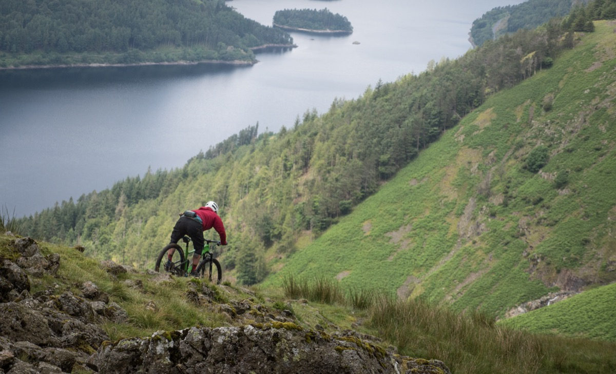 Rockstop rider descending down a trail in the Lake District