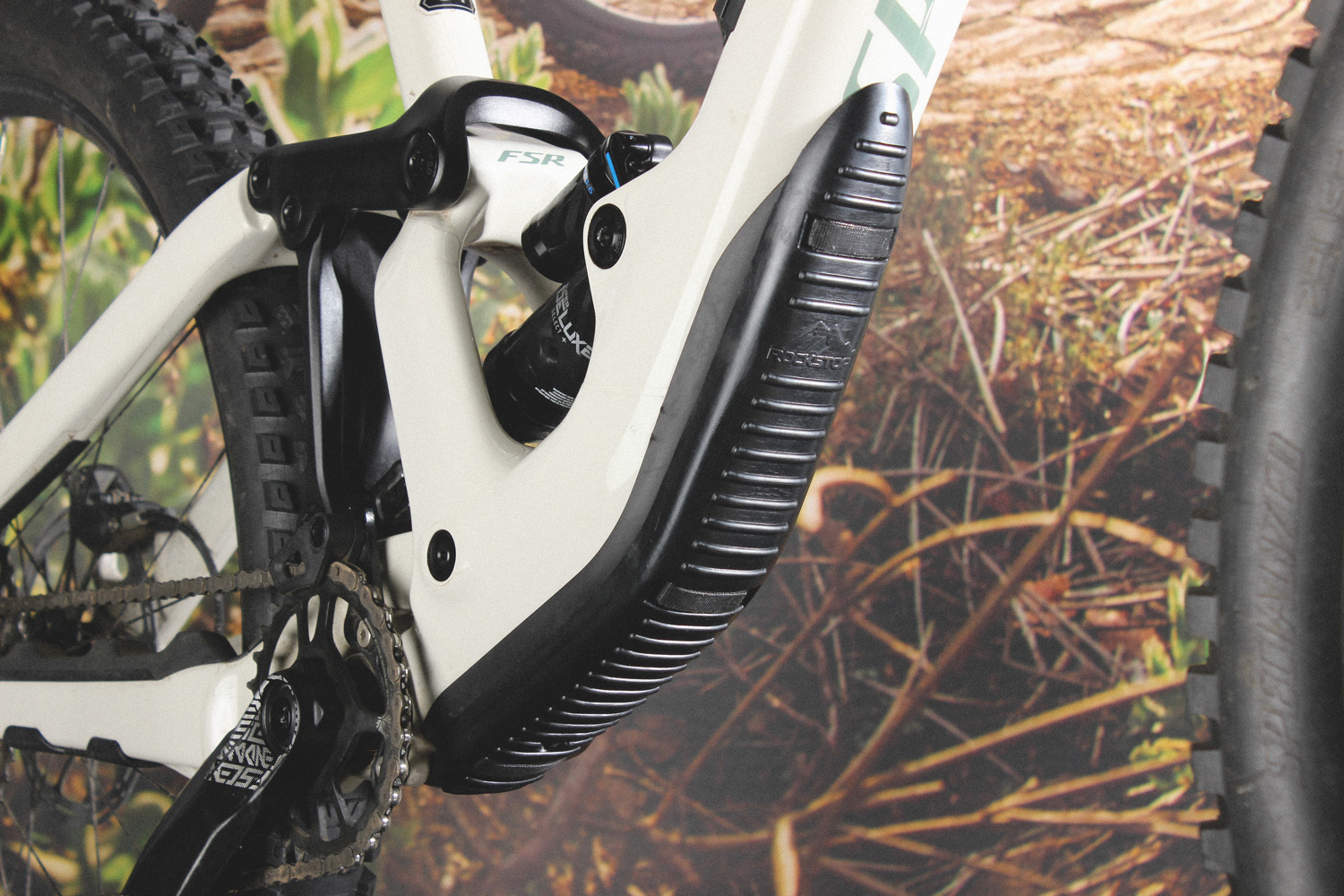 A close up image of Frameguard situated on a white carbon frame mountain bike.