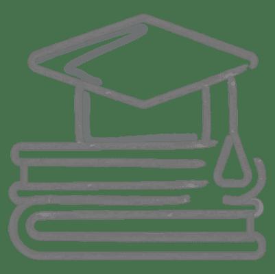 A graduation cap on top of books.