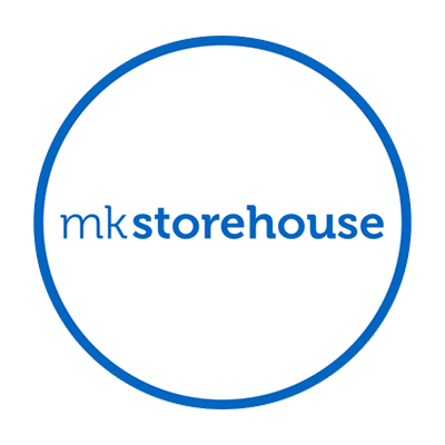 MK storehouse logo. It is the words MK storehouse, in blue, surrounded by a blue circle.