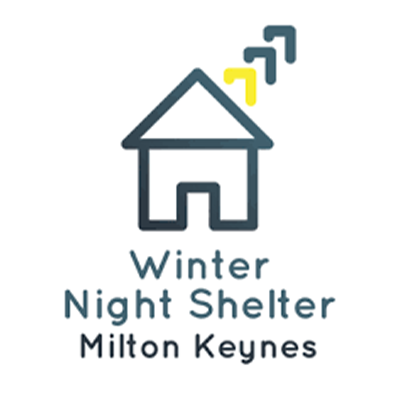 Winter Night Shelter MK logo. It is a graphic logo of a line drawn house. The house is dark blue and has dark blue and yellow representation of smoke from a chimney on the right hand side. Underneath are the words 'winter Night Shelter Milton Keynes in dark blue and grey.