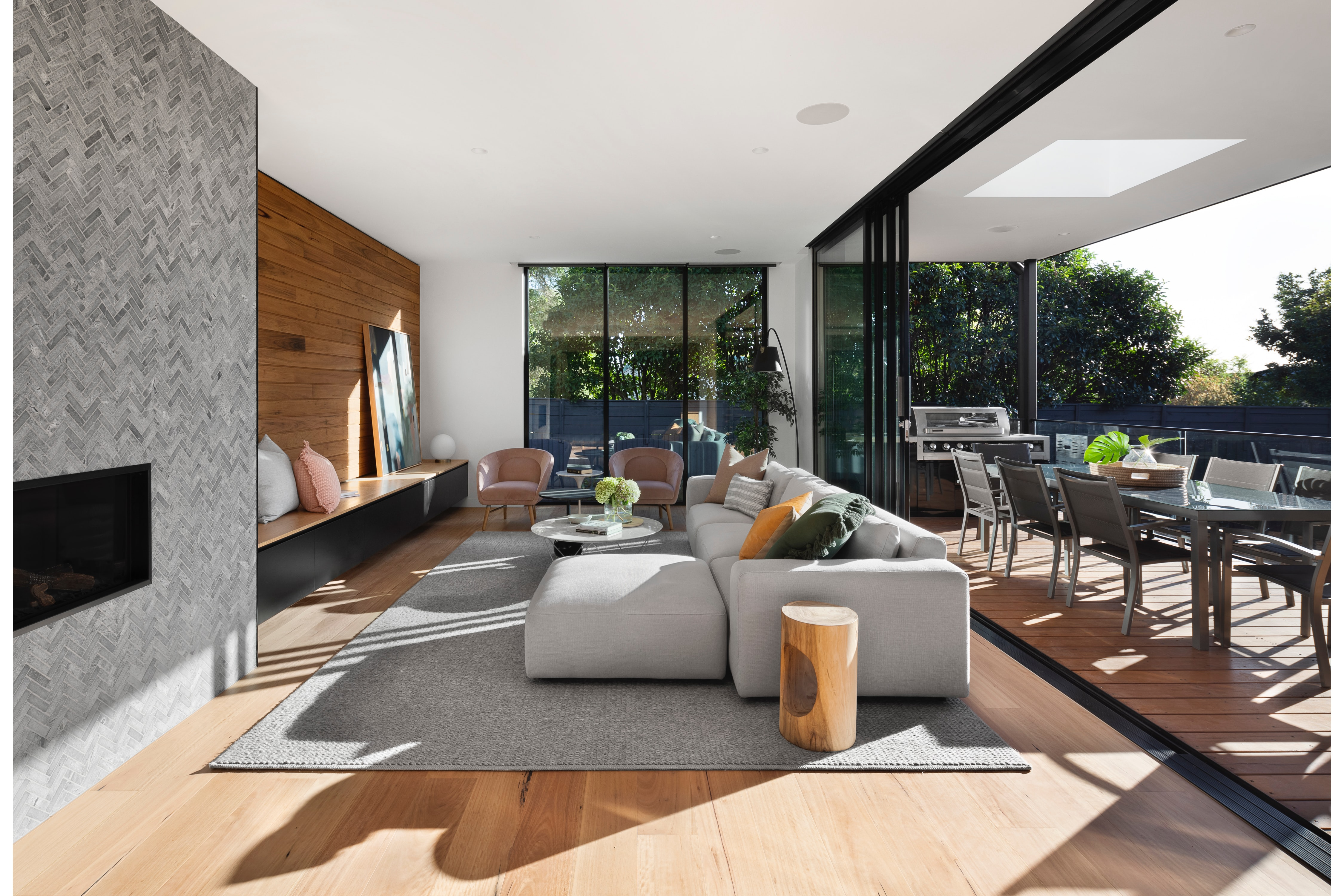 A modern residential interior with polished concrete floor