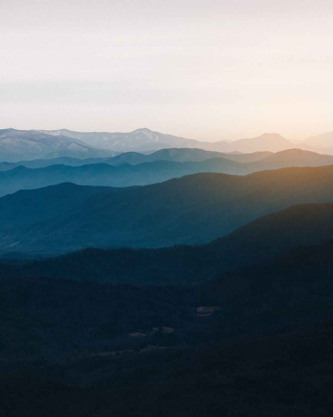 Artistic photo of view over range of hills at sunrise