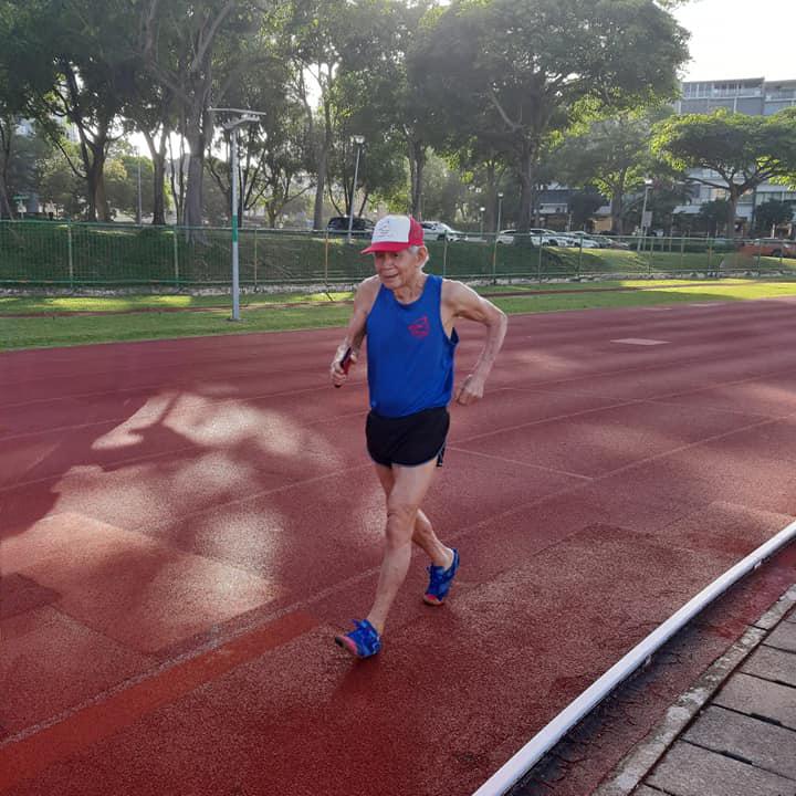 Dr Leong Lee San racewalking on a stadium track