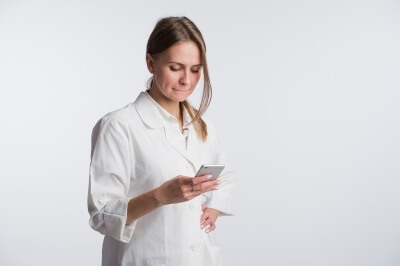 doctor using secure texting on mobile device