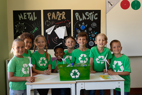 Children pose for a photo during a recycling class