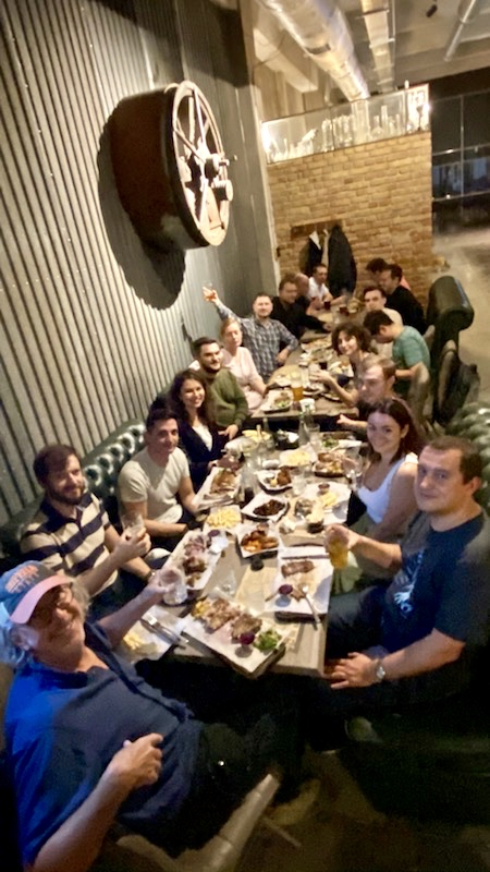 The Starlight team celebrates at a restaurant