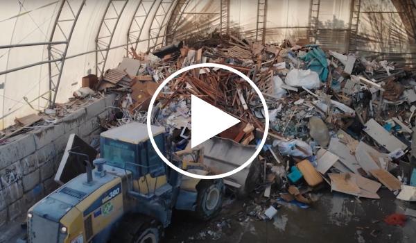 A video screenshot of a recycling dump site
