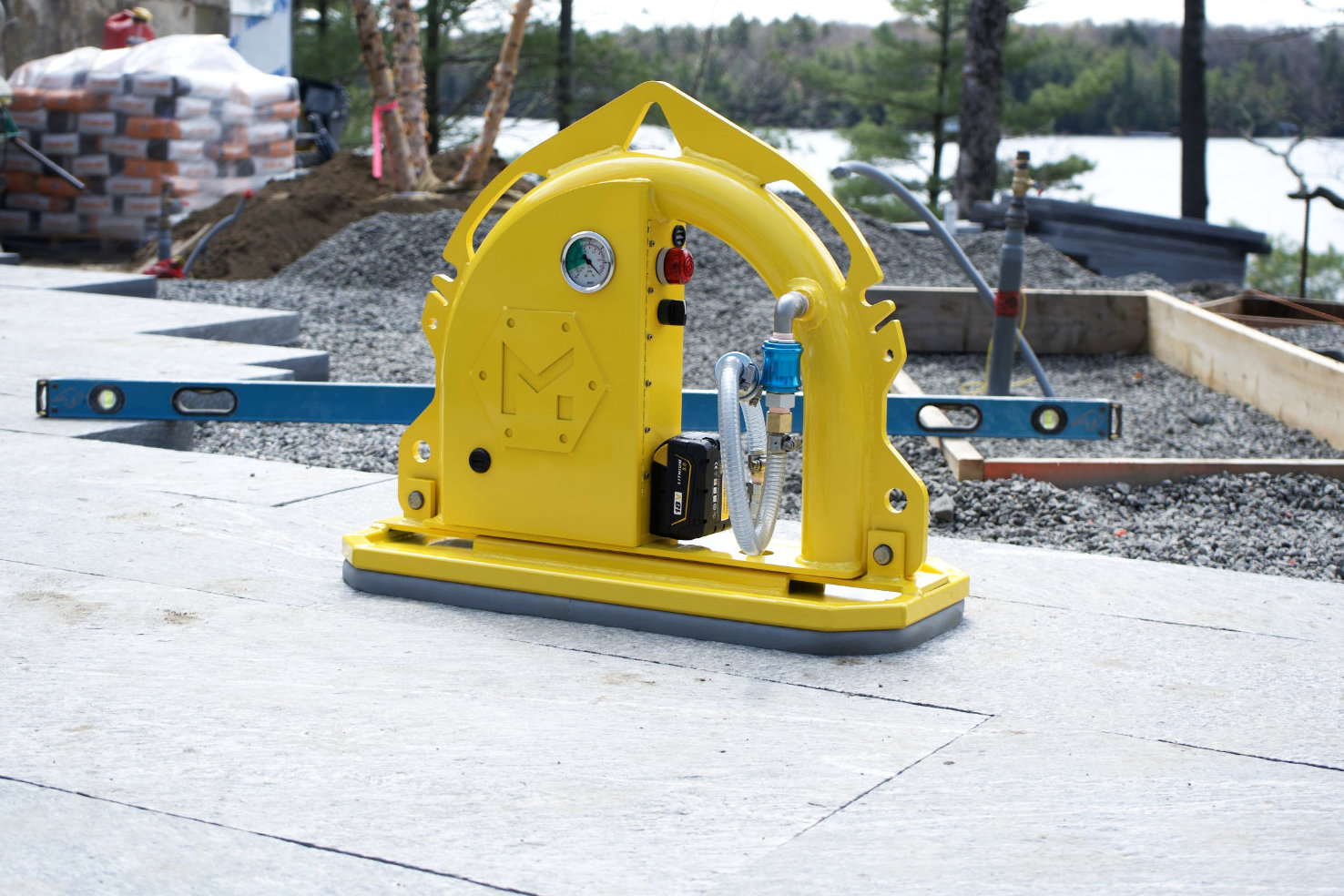 MQUIP Mini Mk2 vacuum lifter sitting on stone.