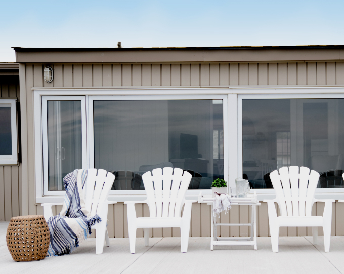 Deck chairs lined up along concrete patio