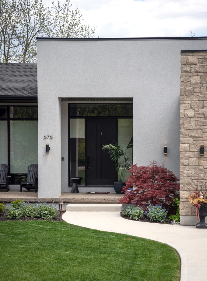 Modern home with concrete path to front door