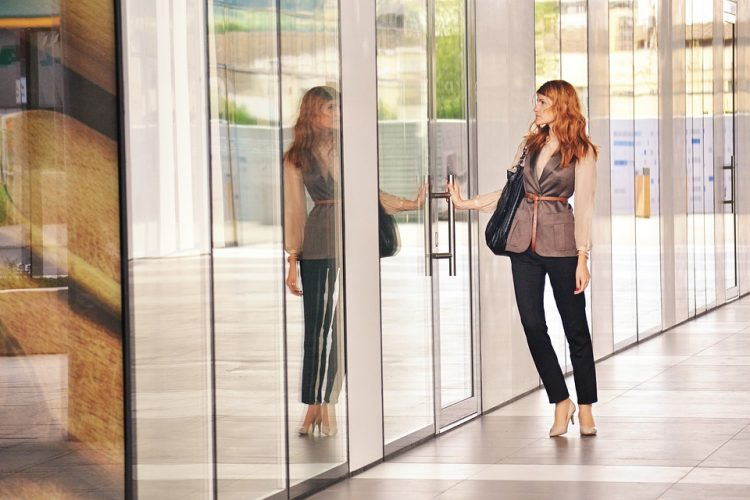 Woman standing in new office after commercial lease incentive was negotiated