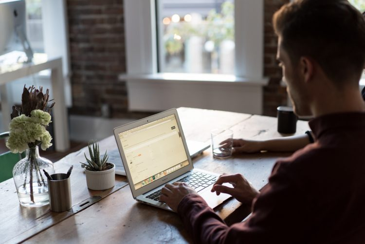 Image of a person sitting at their office desk | Negotiating sublease article