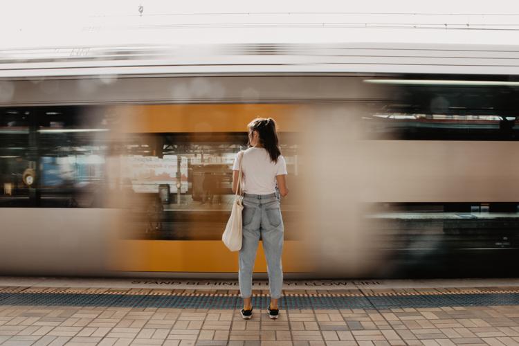 Image of a girl standing on a platform of a Sydney train station | Spotlight on Sydney article