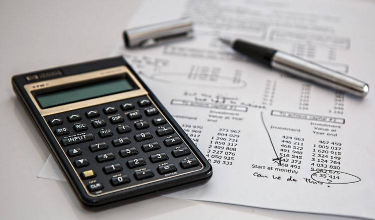 Image of a calculator and random financial statements