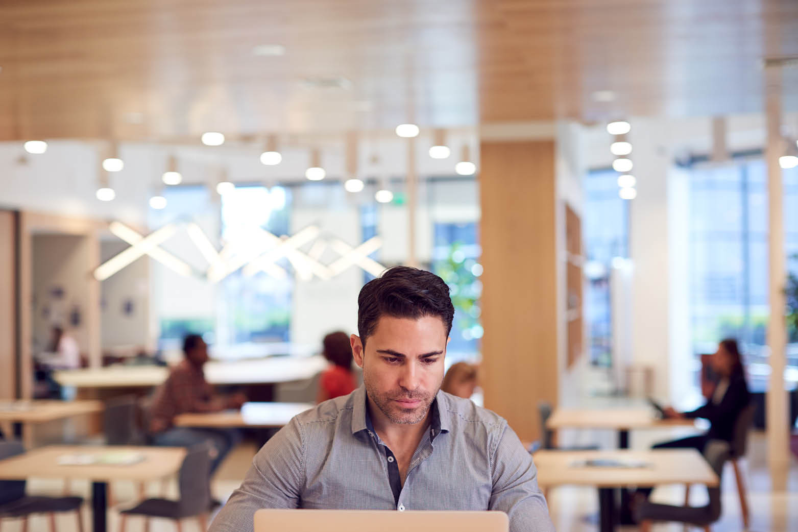 Office worker working in office representing commercial subleasing agreement