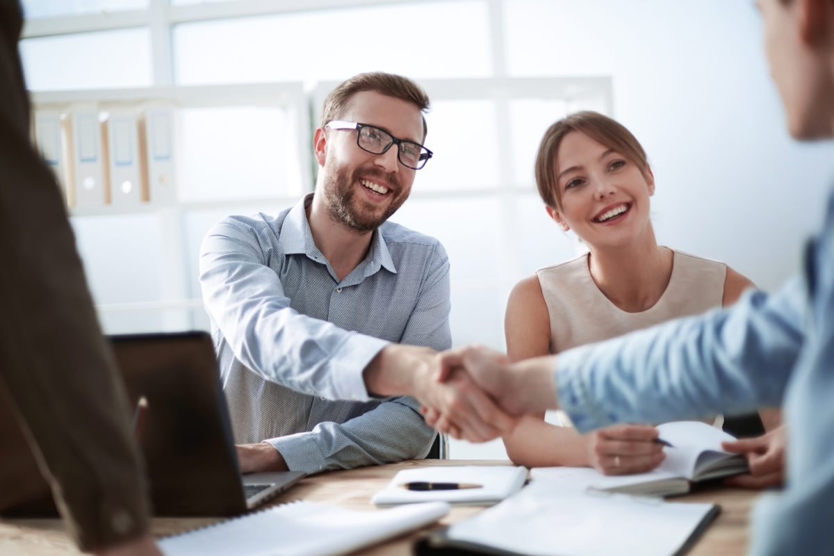 Image of two people shaking hands to represent commercial lease negotiation
