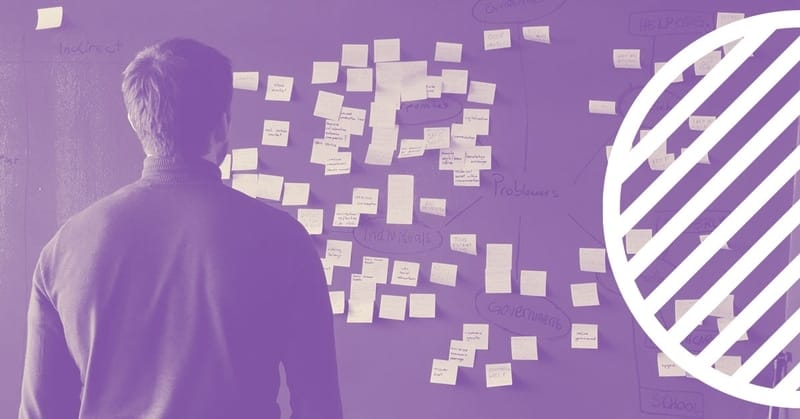 Image of person looking at post its