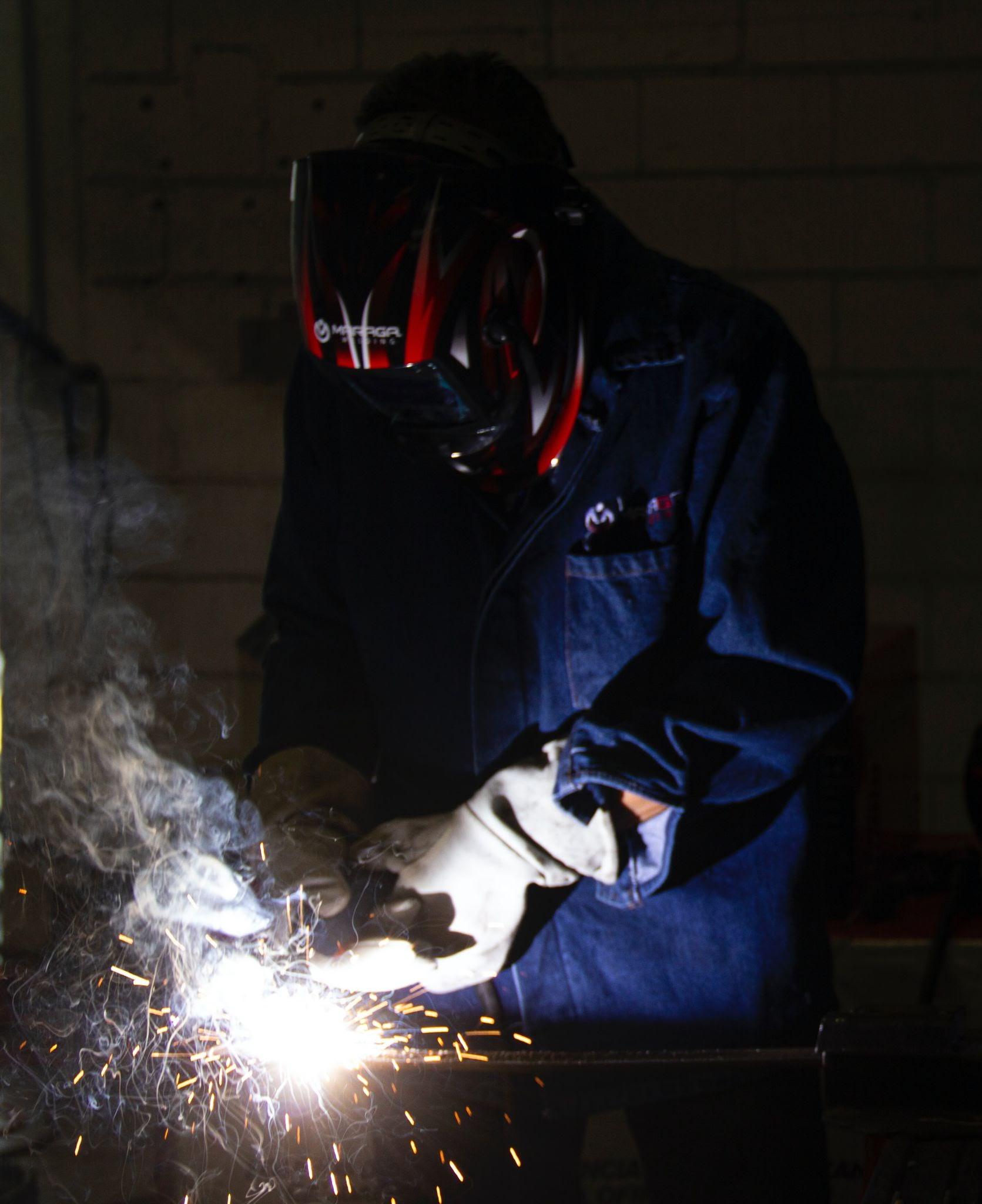 man using fabrication tool