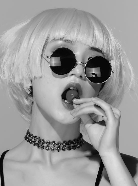 asian lady tasting a lollipop bw