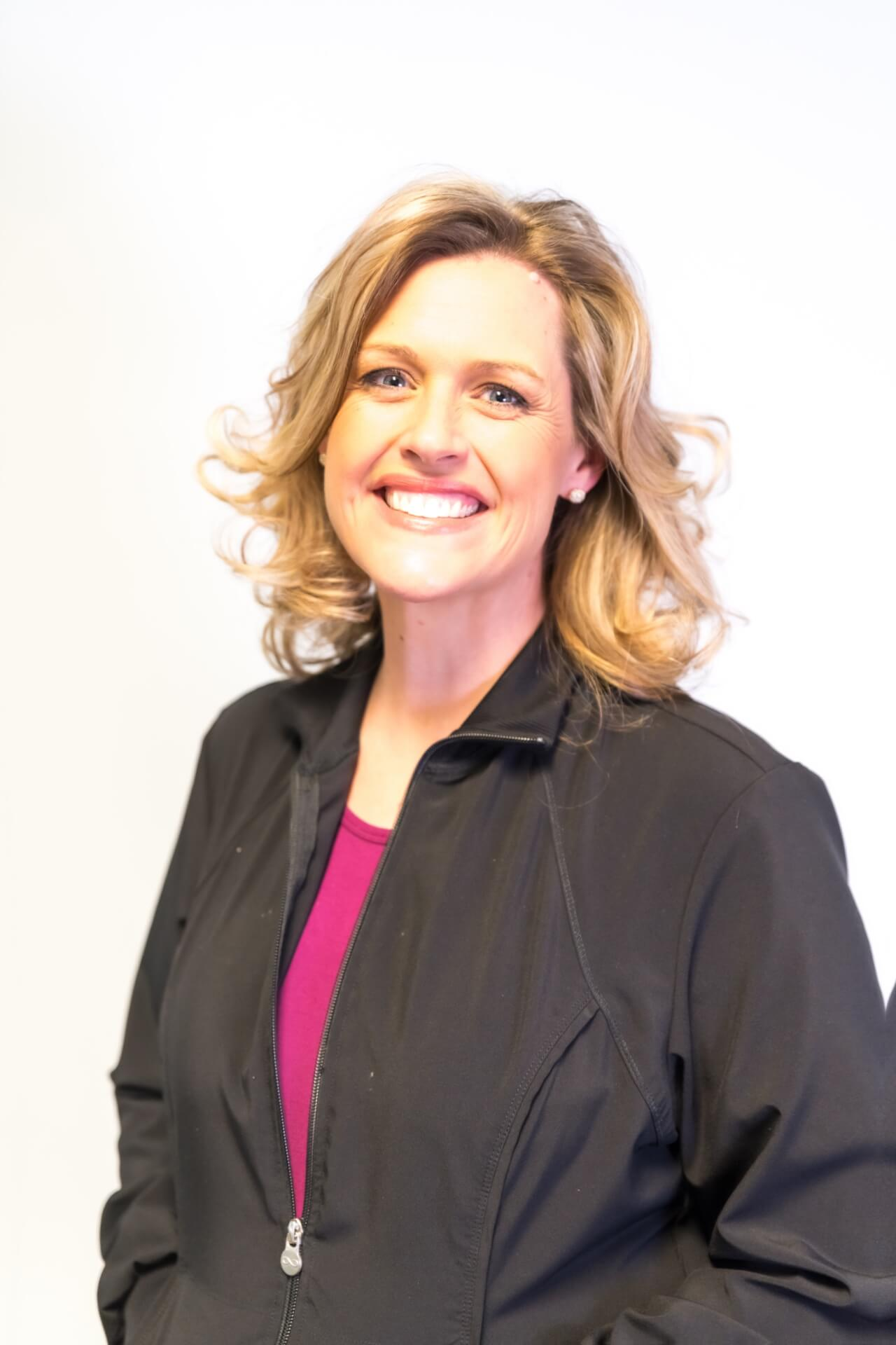 Stacey helps educate patients about their teeth cleaning and gum health